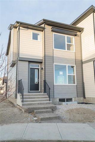 Photo 1: 1341 WALDEN Drive SE in Calgary: Walden Semi Detached for sale : MLS®# C4198713
