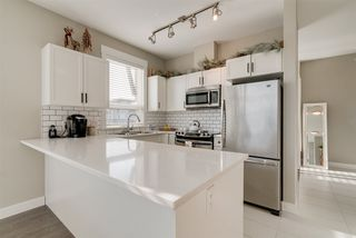 """Photo 10: 402 33538 MARSHALL Road in Abbotsford: Central Abbotsford Condo for sale in """"THE CROSSING"""" : MLS®# R2324427"""
