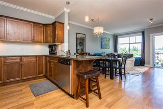 """Photo 2: 401 33338 MAYFAIR Avenue in Abbotsford: Central Abbotsford Condo for sale in """"The Sterling"""" : MLS®# R2384664"""