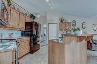 Photo 9: 707 HIGH COUNTRY Drive NW: High River Detached for sale : MLS®# A1035309