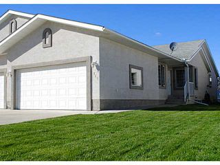 Photo 1: 110 RIVERSIDE Crescent NW: High River Residential Attached for sale : MLS®# C3586695