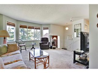 Photo 4: 11303 11 Street SW in Calgary: Southwood House for sale : MLS®# C4013278
