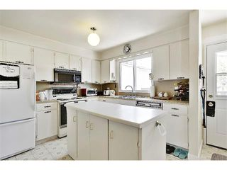 Photo 10: 11303 11 Street SW in Calgary: Southwood House for sale : MLS®# C4013278
