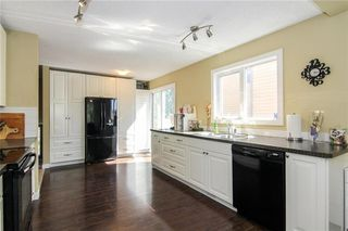 Photo 12: 14719 DEER RIDGE Drive SE in Calgary: Deer Ridge House for sale : MLS®# C4133557