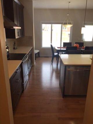 Photo 8: 18 Mount Rae Ridge: Okotoks House for sale : MLS®# C4144821