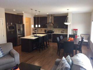 Photo 4: 18 Mount Rae Ridge: Okotoks House for sale : MLS®# C4144821