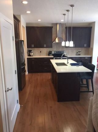 Photo 7: 18 Mount Rae Ridge: Okotoks House for sale : MLS®# C4144821