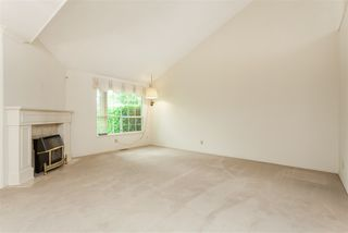 """Photo 2: 105 9781 148A Street in Surrey: Guildford Townhouse for sale in """"Chelsea Gate"""" (North Surrey)  : MLS®# R2375333"""