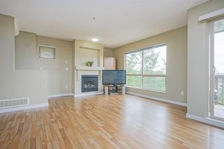 "Photo 2: 11 20350 68 Avenue in Langley: Willoughby Heights Townhouse for sale in ""SUNRIDGE"" : MLS®# R2389347"