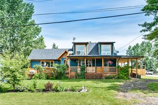 Photo 2: 201 Royalties Crescent: Longview Detached for sale : MLS®# A1011778