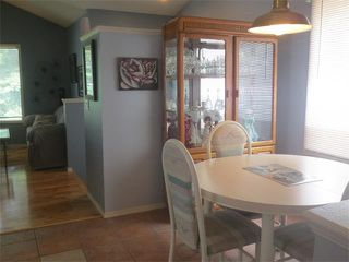 Photo 9: 101 TARARIDGE Close NE in Calgary: Taradale House for sale : MLS®# C4019652