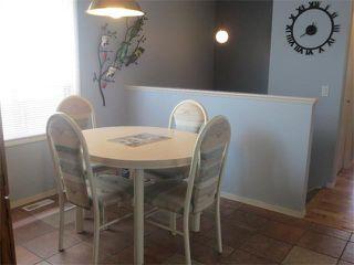 Photo 8: 101 TARARIDGE Close NE in Calgary: Taradale House for sale : MLS®# C4019652