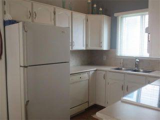 Photo 7: 101 TARARIDGE Close NE in Calgary: Taradale House for sale : MLS®# C4019652