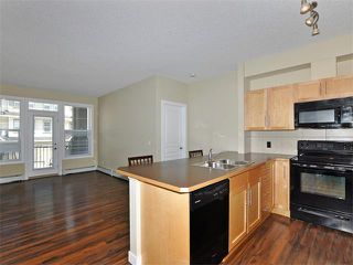 Photo 10: 203 48 PANATELLA Road NW in Calgary: Panorama Hills Condo for sale : MLS®# C4111419