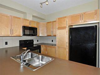 Photo 9: 203 48 PANATELLA Road NW in Calgary: Panorama Hills Condo for sale : MLS®# C4111419