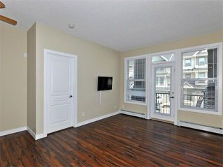 Photo 5: 203 48 PANATELLA Road NW in Calgary: Panorama Hills Condo for sale : MLS®# C4111419
