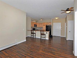 Photo 7: 203 48 PANATELLA Road NW in Calgary: Panorama Hills Condo for sale : MLS®# C4111419