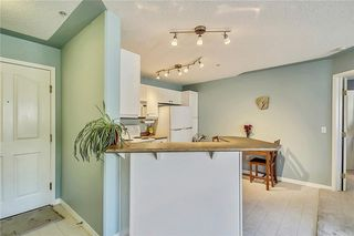 Photo 3: Rocky Ridge Condo Sold By Sotheby's - Steven Hill - Certified Condominium Specialist
