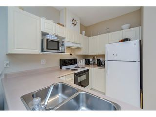 """Photo 10: 305 2109 ROWLAND Street in Port Coquitlam: Central Pt Coquitlam Condo for sale in """"Parkview Place"""" : MLS®# R2195061"""