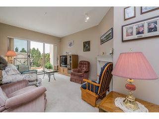"""Photo 3: 305 2109 ROWLAND Street in Port Coquitlam: Central Pt Coquitlam Condo for sale in """"Parkview Place"""" : MLS®# R2195061"""
