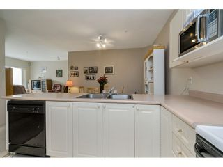 """Photo 11: 305 2109 ROWLAND Street in Port Coquitlam: Central Pt Coquitlam Condo for sale in """"Parkview Place"""" : MLS®# R2195061"""