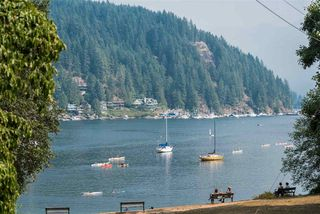 Photo 1: 2035 ROCKCLIFF Road in North Vancouver: Deep Cove House for sale : MLS®# R2210600