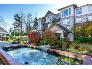 "Photo 1: 401 2167 152 Street in Surrey: Sunnyside Park Surrey Condo for sale in ""Muirfield Gardens"" (South Surrey White Rock)  : MLS®# R2217590"