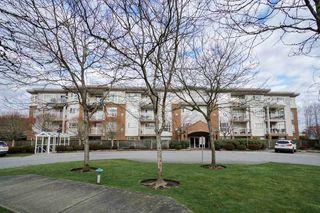 "Photo 1: 402 15885 84 Avenue in Surrey: Fleetwood Tynehead Condo for sale in ""Abbey Road"" : MLS®# R2334169"