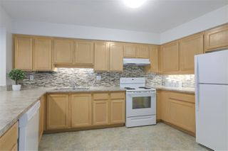 "Photo 1: 403 2963 BURLINGTON Drive in Coquitlam: North Coquitlam Condo for sale in ""Burlington Estates"" : MLS®# R2369043"