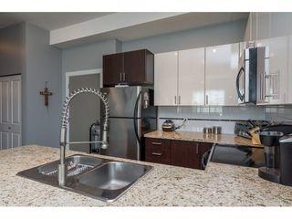 """Photo 8: 411 14960 102A Avenue in Surrey: Guildford Condo for sale in """"MAX"""" (North Surrey)  : MLS®# R2208496"""