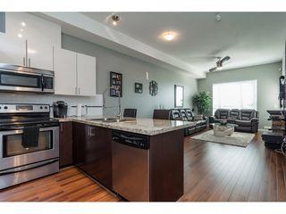 """Photo 10: 411 14960 102A Avenue in Surrey: Guildford Condo for sale in """"MAX"""" (North Surrey)  : MLS®# R2208496"""