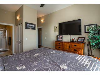 """Photo 12: 411 14960 102A Avenue in Surrey: Guildford Condo for sale in """"MAX"""" (North Surrey)  : MLS®# R2208496"""