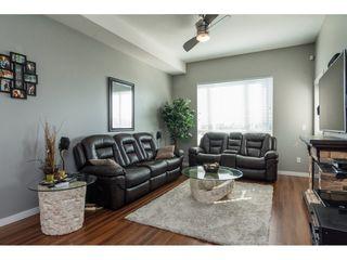 """Photo 4: 411 14960 102A Avenue in Surrey: Guildford Condo for sale in """"MAX"""" (North Surrey)  : MLS®# R2208496"""