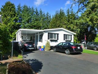 "Photo 1: 31 2305 200 Street in Langley: Brookswood Langley Manufactured Home for sale in ""Cedar Lane"" : MLS®# R2223523"
