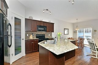 Photo 2: 136 Reunion Close NW: Airdrie House for sale : MLS®# C4170795