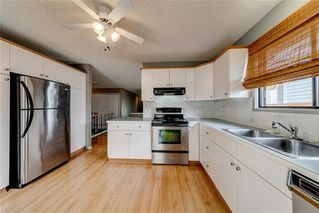 Photo 4: 228 WOODBINE Boulevard SW in Calgary: Woodbine Detached for sale : MLS®# C4204614
