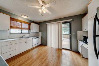 Photo 2: 228 WOODBINE Boulevard SW in Calgary: Woodbine Detached for sale : MLS®# C4204614