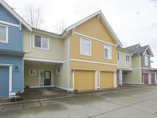 "Photo 1: 4 4910 CENTRAL Avenue in Delta: Hawthorne Townhouse for sale in ""CENTRAL PARK"" (Ladner)  : MLS®# R2355391"