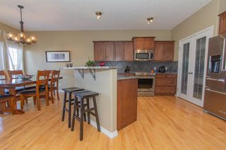 Photo 10: 732 Coopers Drive SW: Airdrie Detached for sale : MLS®# A1058696