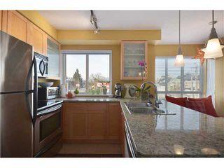 """Photo 4: # 201 702 E KING EDWARD AV in Vancouver: Fraser VE Condo for sale in """"THE MAGNOLIA"""" (Vancouver East)  : MLS®# V934225"""