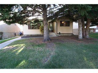 Photo 4: 421 HUNTINGTON Way NE in Calgary: Huntington Hills House for sale : MLS®# C4034997