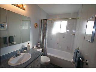Photo 12: 421 HUNTINGTON Way NE in Calgary: Huntington Hills House for sale : MLS®# C4034997