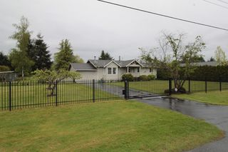 "Photo 1: 24277 58 Avenue in Langley: Salmon River House for sale in ""Strawberry Hills"" : MLS®# R2166829"