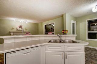 Photo 7: 3774 DOUGLAS RIDGE Link SE in Calgary: Douglasdale/Glen House for sale : MLS®# C4166740