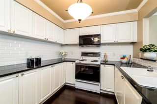 """Photo 9: 409 2288 W 12TH Avenue in Vancouver: Kitsilano Condo for sale in """"CONNAUGHT POINT"""" (Vancouver West)  : MLS®# R2256877"""