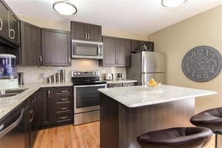 Photo 3: 1317 3240 66 Avenue SW in Calgary: Lakeview Row/Townhouse for sale : MLS®# C4214775