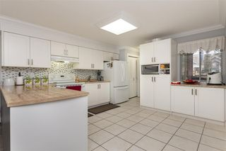 """Photo 6: 101 12109 78 Avenue in Surrey: West Newton Townhouse for sale in """"Camus Gardens"""" : MLS®# R2337288"""