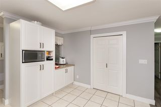 """Photo 9: 101 12109 78 Avenue in Surrey: West Newton Townhouse for sale in """"Camus Gardens"""" : MLS®# R2337288"""