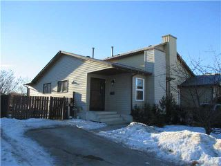 Photo 1: 220 DEERVIEW Court SE in CALGARY: Deer Ridge Residential Attached for sale (Calgary)  : MLS®# C3598033