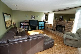 Photo 11: 64 STRATHCONA Close SW in Calgary: Strathcona Park House for sale : MLS®# C4142880